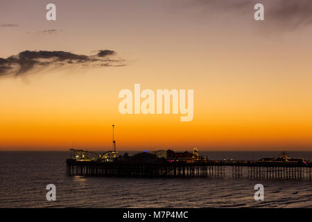 The Brighton Palace Pier, commonly known as Brighton Pier or the Palace Pier is a Grade II listed pleasure pier - Stock Photo