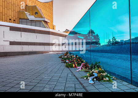 Berlin, Mitte. Blue glass wall Memorial in front of Berlin Philharmonic Concert hall. Monument to disabled victims - Stock Photo