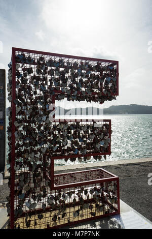 Lovers' Locks on E of LOVE - Stock Photo