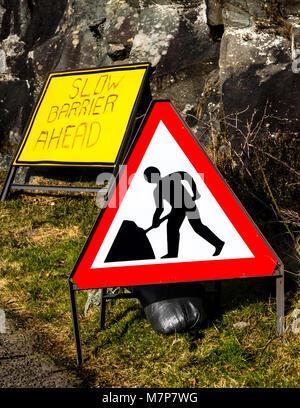 Triangular roadworks ahead warning sign, Scotland. - Stock Photo