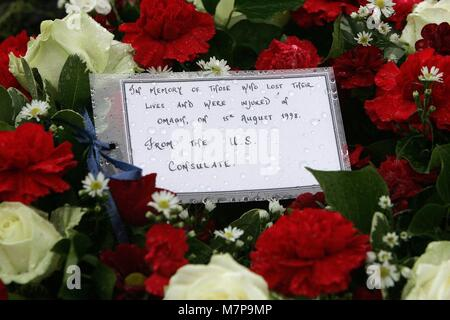 A floral tribute from the United States Consulate in Belfast is seen at the Omagh Memorial Garden on August 15, - Stock Photo