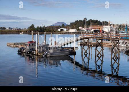 Sitka, Alaska: Fishing boats docked in Sitka Harbor. In the distance is Mount Edgecumbe on neighboring Kruzof Island. - Stock Photo