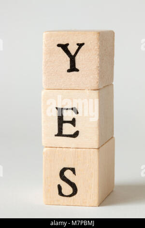 YES Word Written In Wooden Blocks - Stock Photo