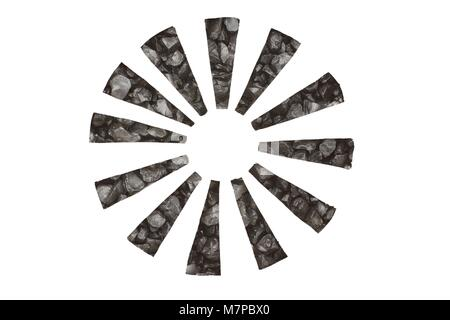 Black stones symbolize arrows in a circle with direction to the center - Stock Photo