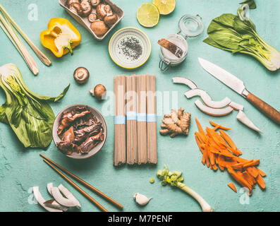 Asian food flat lay with tasty ingredients: Mu Err Mushrooms , various vegetables , pok choi , coconut milk, lemongrass - Stock Photo