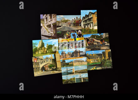 Ten assorted J Salmon Ltd postcards depicting English and Welsh views, shown on a black background. - Stock Photo