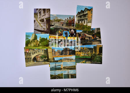Ten assorted J Salmon Ltd postcards depicting English and Welsh views, shown on a white background. - Stock Photo