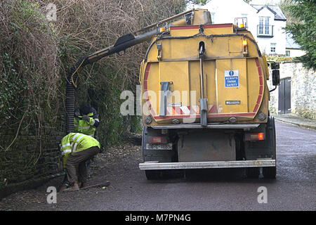 council workmen clearing blocked road drains in Castletownshend, West Cork, Ireland - Stock Photo
