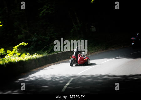 A motorbike and sidecar travel around the Isle of Man during the 100 Centenary TT Races on the Isle of Man. - Stock Photo