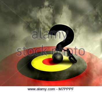 Businessman pushing large question mark into bull's-eye on target - Stock Photo