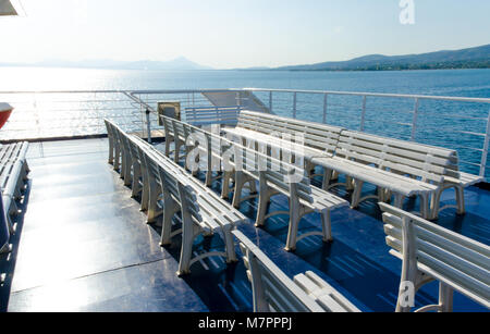 Plastic white seats in a row upon a ferry boat - Stock Photo