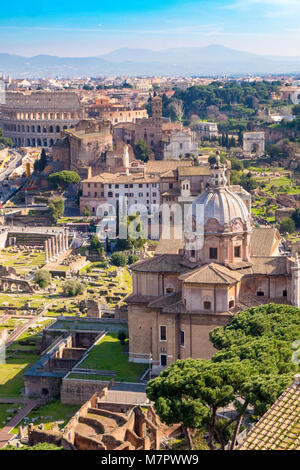 Aerial view of the Roman Forum and Colosseum in Rome, Italy. Rome from above. - Stock Photo