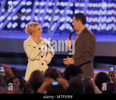 LOS ANGELES, CA - DECEMBER 04: Singer Britney Spears lights the tree on stage at the 'Light of the Angels' Holiday - Stock Photo