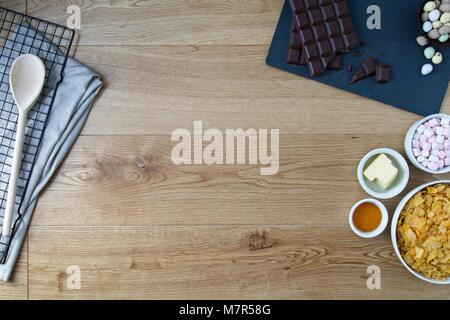 Corn flake cake ingredients on oak surface for easter - Stock Photo