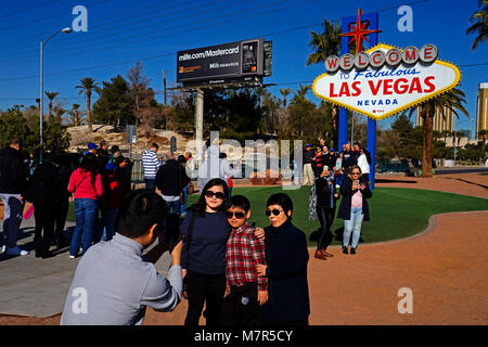 Tourists having photograph next to Famous Sign welcome to Las Vegas,Nevada,USA - Stock Photo
