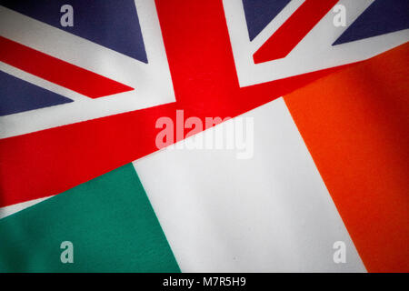 british union flag and irish tricolour flag brexit flags - Stock Photo