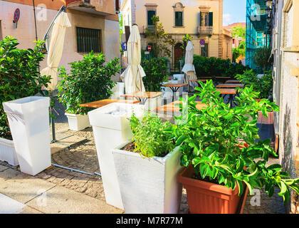 Street cafe on Corso Umberto Street in Olbia, Sardinia, Italy - Stock Photo
