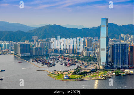 Panorama of Kowloon peninsula and Victoria Harbour, showing highrises in the western cultural district and  Yau - Stock Photo