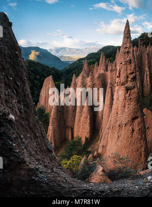 Earth pyramids with stones on top in Renon Ritten region, South Tyrol, Italy. - Stock Photo