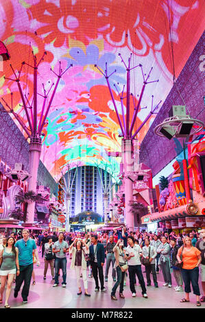 Las Vegas, USA - May 19, 2012. Tourists watch the light show on the canopy above Fremont Street. - Stock Photo