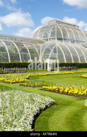 London, UK - April 18, 2014. Formal garden outside the Palm House at Kew Botanic Gardens. The gardens were founded - Stock Photo