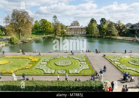 London, UK - April 18, 2014. Museum No 1, lake and formal gardens in Kew Royal Botanic Gardens. The gardens were - Stock Photo