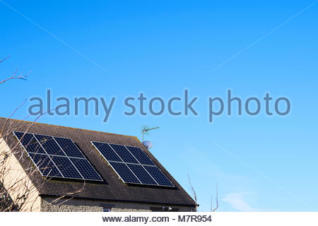 Solar panels on roof of house in Stonesfield in Oxfordshire in the Cotswolds - Stock Photo