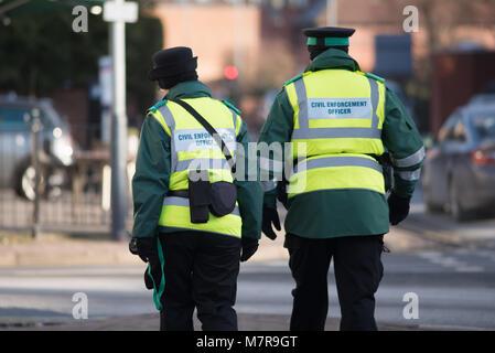 civil enforcement traffic wardens walking down street together - Stock Photo