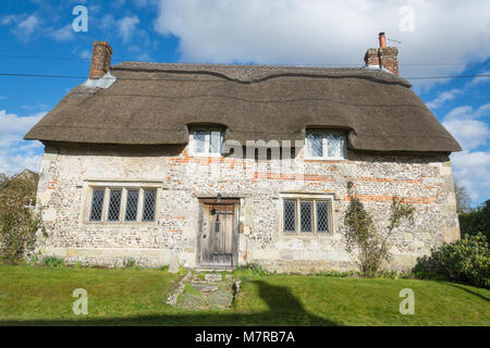 Charming thatched cottage in Martin village in Hampshire, UK - Stock Photo