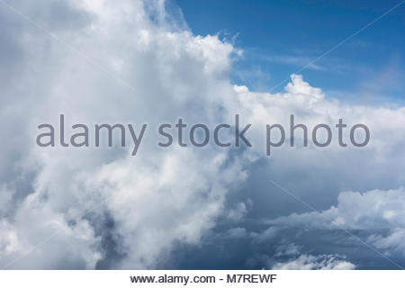 Warm moist air rising over mountainous Hawaiian islands create cumulonimbus clouds a hydrologic cycle in the state - Stock Photo