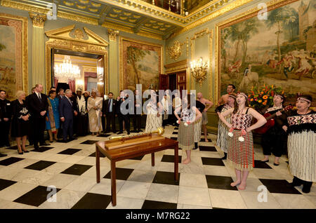 Guests enjoy a performance at a reception held at Marlborough House, the home of the Commonwealth Secretariat in - Stock Photo
