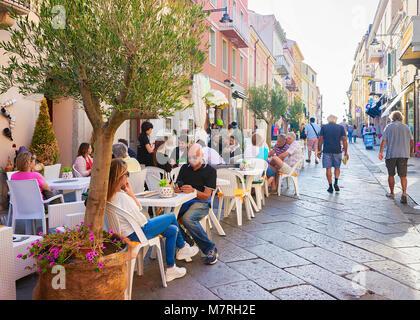 Olbia, Italy - September 11, 2017: People at street cafe at Corso Umberto Street in Olbia, Sardinia, Italy - Stock Photo