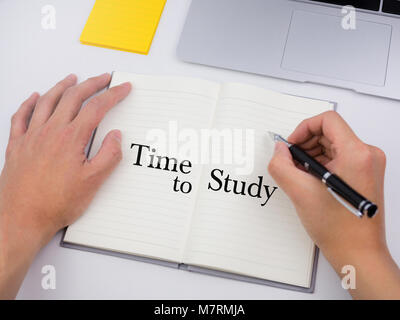 Time to study on notebook with hands writing - Stock Photo