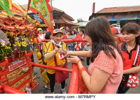 Karawang, West Java. Indonesia, 11 March 2018. Some Chinese people giving money as a charity to The Dragon Dancers - Stock Photo