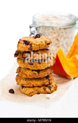 Homemade  pumpkin and orange cookies on white background - Stock Photo