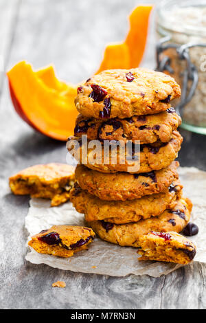Homemade  pumpkin and orange cookies on rustic wooden background - Stock Photo
