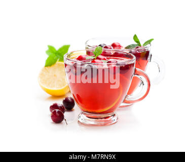 Red  fruit tea with lemon and cranberry isolated on white background - Stock Photo