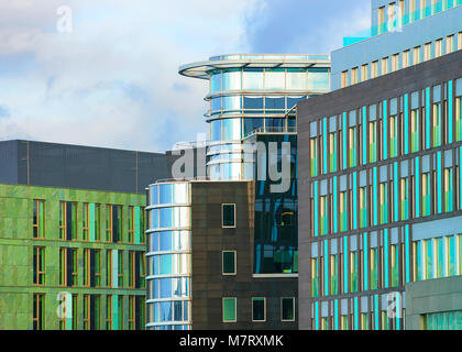 Berlin, Germany - December 8, 2017: Modern glass office building at Berlin Mitte, Germany - Stock Photo