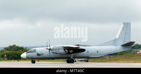 Military transport turbojet aircraft parked at the airbase - Stock Photo