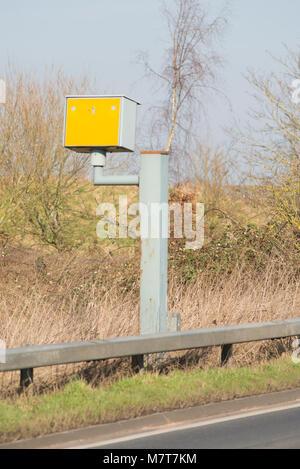 yellow gatso speed camera on roadside - Stock Photo