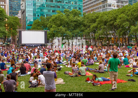 Crowds gathered in Bryant Park , Manhattan for Bryant Park Film Festival , New York ,NY - Stock Photo