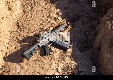 Smuggler's gun from the desert - Stock Photo