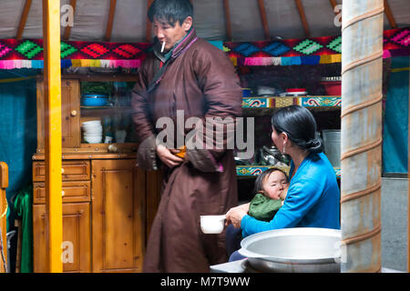 Hatgal, Mongolia, 3rd March 2018: mongolian family in their home ger, mother breastfeeding her baby - Stock Photo