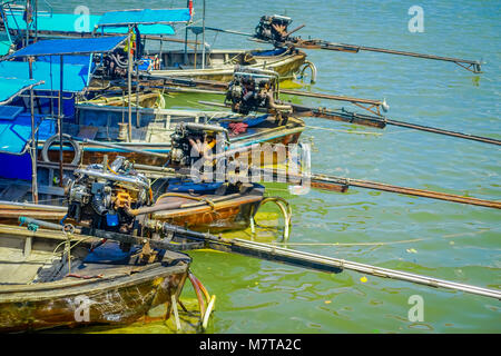 AO NANG, THAILAND - FEBRUARY 19, 2018: Above view of long tail fishing boats in a row at the riverside in the pier - Stock Photo
