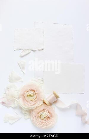Feminine wedding, birthday desktop mock-up scene. Blank craft paper greeting cards, silk ribbon and blush pink Persian - Stock Photo