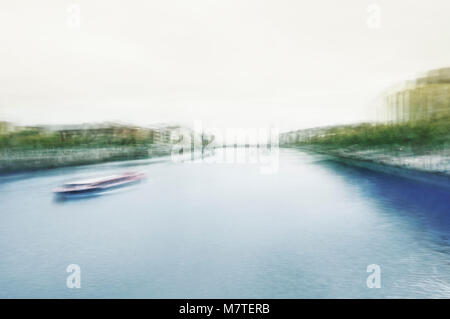 Montage of multiple exposures of river Liffey with boat in Dublin City center. ICM (In Camera Motion). - Stock Photo