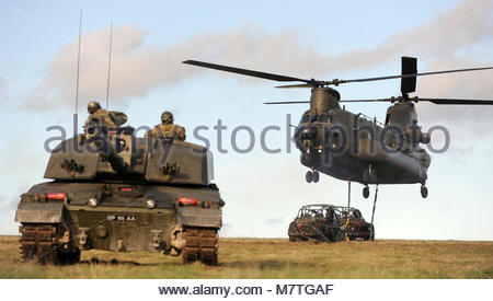 ArmyHQ-2014-023 RWxY Ex Spring Warrior-051. Pictured is a Challenger 2 MBT and Chinook Helicopter on the Salisbury - Stock Photo