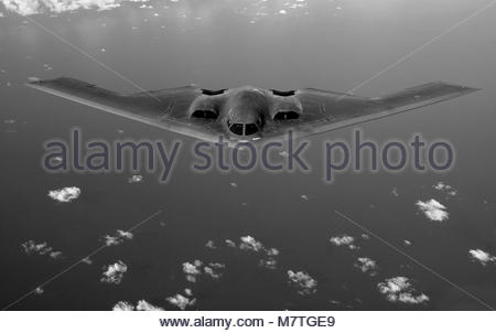 B-2 Spirit. OVER THE PACIFIC OCEAN -- A B-2 Spirit soars through the sky after a refueling mission, 30 May, 2006. - Stock Photo