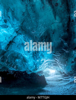Interior of a blue ice cave at the Vatnajokull Glacier, the largest glacier in Europe, near Jokulsarlon, Iceland - Stock Photo