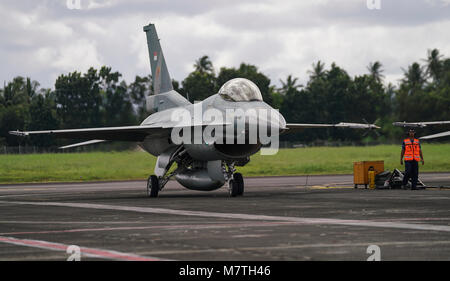 An Indonesian air force F-16 Fighting Falcon prepares to takeoff during exercise Cope West 18 (CW18) from Sam Ratulangi - Stock Photo